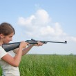 Girl with air rifle — Stock Photo #2114757