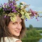 Girl in flower chaplet — Stock Photo
