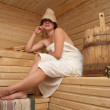 Young woman is sitting at sauna bath — Stock Photo