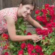 Girl florists working in the garde - Stock Photo