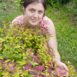 Girl with spiraea in garden — Stock Photo