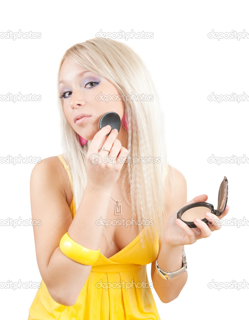 Young woman putting make up on her face. Isolated  Stock Photo #2113672
