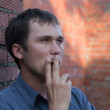 Portrait of smoking man — Stock Photo