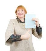 Senior woman holding empty poster — Stock Photo