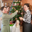 Family decorating Christmas tree at home — Stock Photo #2130168