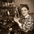 Retro girl decorating Christmas tree — Stock Photo #2130313