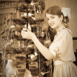 Teen girl decorating Christmas - Stock Photo