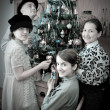 Retro Family near Christmas tree - Stock Photo