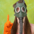 Royalty-Free Stock Photo: Girl in gas mask pointing ATTENTION
