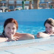 Girls in swimming pool — Stock Photo
