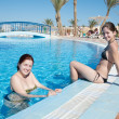 Women enjoying a swimming pool - Stock Photo