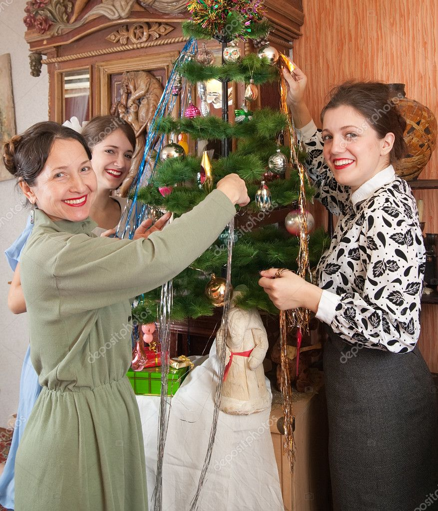 Teen girls with mother decorating Christmas tree at home  Stock Photo #2130168