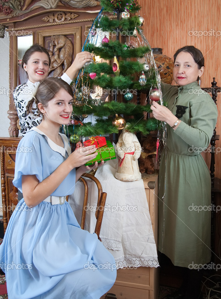 Three women decorating Christmas tree at home — Stock Photo #2130208