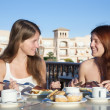Two smiling girls having lunch — Stock Photo