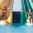 Girls riding down a waterslide — Stock Photo
