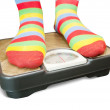 Feet on  bathroom scale — Stock Photo