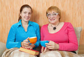 Two women have tea — Stock Photo