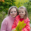 Woman with daughter in autumn — Stock Photo