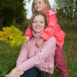 Mother with daughter on meadow — Stock Photo