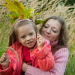 Stock Photo: Mother with daughter on meadow