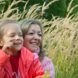 Mother with daughter on meadow — Stock Photo #2150892