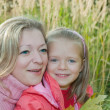 Mother with daughter on meadow — Stock Photo #2153910
