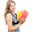 Schoolgirl with books over white — Stock Photo