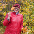 Stock Photo: Old lady in autumn park.