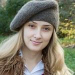 Smiling girl in beret — Stock Photo