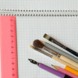 Stock Photo: Stationery on copybook