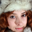 Portrait of girl in polar fox cap — Stock Photo