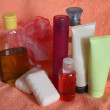 Toiletries on pink towel — Stock Photo