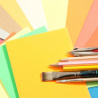School supplies on colored papers — Stock Photo