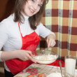 Stock Photo: Young women doing omelet