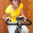 Girl exercising at exercycle — Stock Photo #2178707