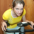 Girl on exercycle - Stock Photo