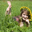 Girl in a chaplet lying from meadow — Stok fotoğraf