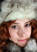 Portrait of girl in polar fox cap — Stock Photo