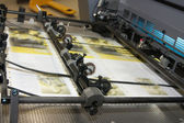 Newspapers at offset printed machine — Stock Photo