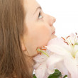 Young woman with lily on white — Stock Photo