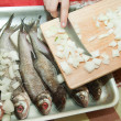 Cooking a fresh  fish — Stock Photo