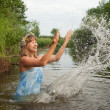 Girl playing into water - Stock Photo