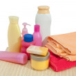 Toiletries with pink towel — Stock Photo