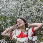 Girl in a spring garden — Stock Photo