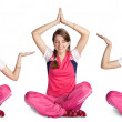 Smiling girl practicing yoga — Stock Photo