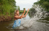 Girl playing into water — Stock Photo
