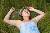 Girl in a flower chaplet — Stock Photo