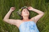 Girl in a flower chaplet — Stock Photo