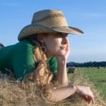 Girl on fresh hay — Stock Photo #2208438