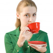 Girl drinks tea from a red cup — Stock Photo